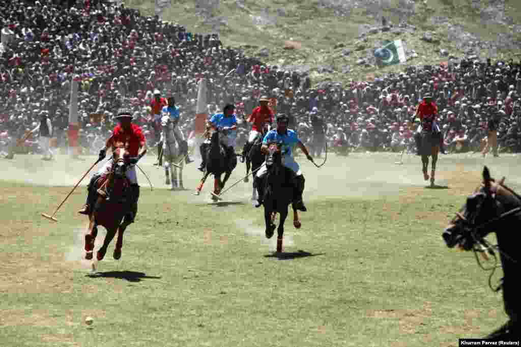 Players fight for the ball during the annual Shandur Polo Festival at Shandur Pass at an estimated altitude of 3,700 meters in Chitral, Pakistan. (Reuters/Khurram Parvez)