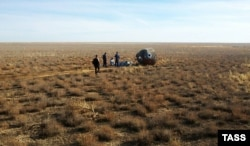 A search-and-rescue team arrives at the emergency landing site on the Kazakh steppe on October 11.