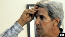 John Kerry was in Pakistan to urge officials to release a U.S. consular employee being held for killing two men.