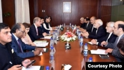FILE: A meeting between Pakistan and Iranian officials led by Pakistan Foriegn Minister Shah Mahmood Qureshi (L-C) and his Iranian counterpart Javad Zarif in August 2018.