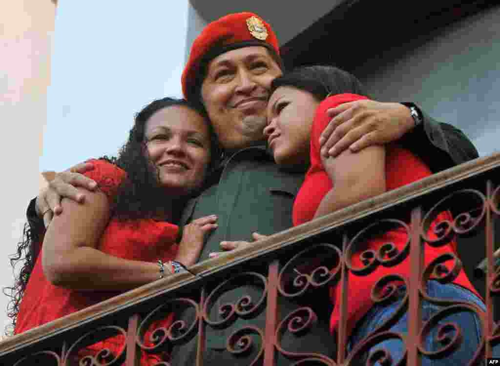 Chavez embraces his daughters Maria (left) and Rosa at the Miraflores Palace in Caracas in July 2011.