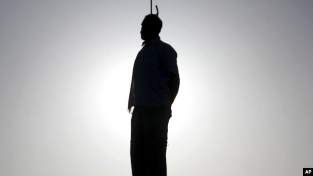 Silhouette of an executed prisoner in Qazvin, near Tehran, on May 26
