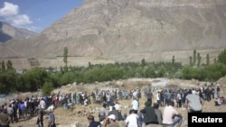 Locals attended the burial of victims of recent fighting in the town of Khorog, the capital of the autonomous region of Gorno-Badakhshan, in July.
