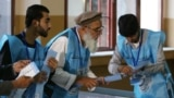 Afghan election commission workers in Kabul prepare ballot papers for counting after the country's presidential election on September 28.