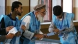 Afghan election commission workers count ballot papers from the September 28 presidential election in Kabul.