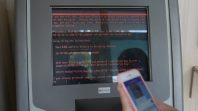 Ukraine -- A message demanding money is seen on a monitor of a payment terminal at a branch of Ukraine's state-owned bank Oschadbank after Ukrainian institutions were hit by a wave of cyber attacks earlier in the day, in Kyiv, June 27, 2017