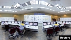 Russian and Iranian operators monitor the nuclear power plant unit at Bushehr.