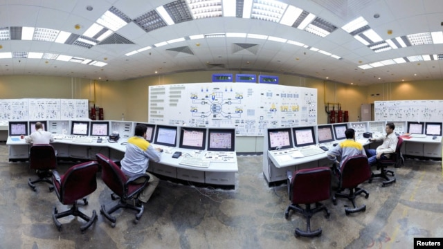 Russian and Iranian operators monitor the nuclear power plant unit in Bushehr, Iran. (file photo)