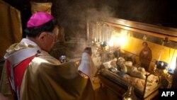 Christian pilgrims gather for Christmas midnight mass in the West Bank city of Bethlehem on December 24.