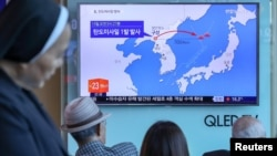 In Seoul, residents watch a news report on North Korea firing a ballistic missile.