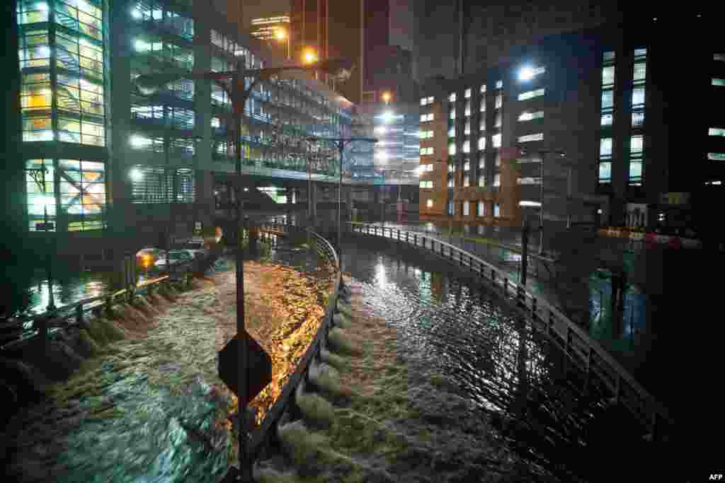 Water rushes into the Carey Tunnel (previously the Brooklyn Battery Tunnel) in the financial district of New York City.