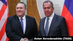U.S. Secretary of State Mike Pompeo (left) and Russian Foreign Minister Sergei Lavrov shake hands as they pose for a photo prior to their talks in the Russian city of Sochi in May.