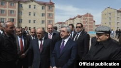 Armenia - President Serzh Sarkisian and Gyumri Mayor Vartan Ghukasian (R) inspect new apartment blocks constructed in Armenia's second largest city, 7Apr2012.