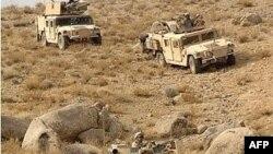 نیروهای بین المللی از ظهر چهارشنبه درگیر نبردهایی در ارقنداب شده اند. (عکس از AFP)