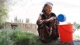 Kyrgyzstan Batken Old lady filling her bucket with water from the stream video grab October 27, 2016