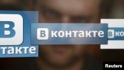 A man in Moscow looks at a computer screen showing logos of Russian social network VKontakte.