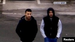 Paris shooting suspect Salah Abdeslam (left) and suspected accomplice Hamza Attou are seen at a filling station on a highway between Paris and Brussels, in Trith-Saint-Leger, France in this still image taken from a November 14, 2015, video.