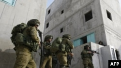 Israeli Army reservists practice at the Urban Warfare Training Center in southern Israel on January 11.