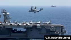 An MV-22 Osprey prepares to land on the flight deck of the USS Abraham Lincoln aircraft carrier in the Arabian Sea on May 17.