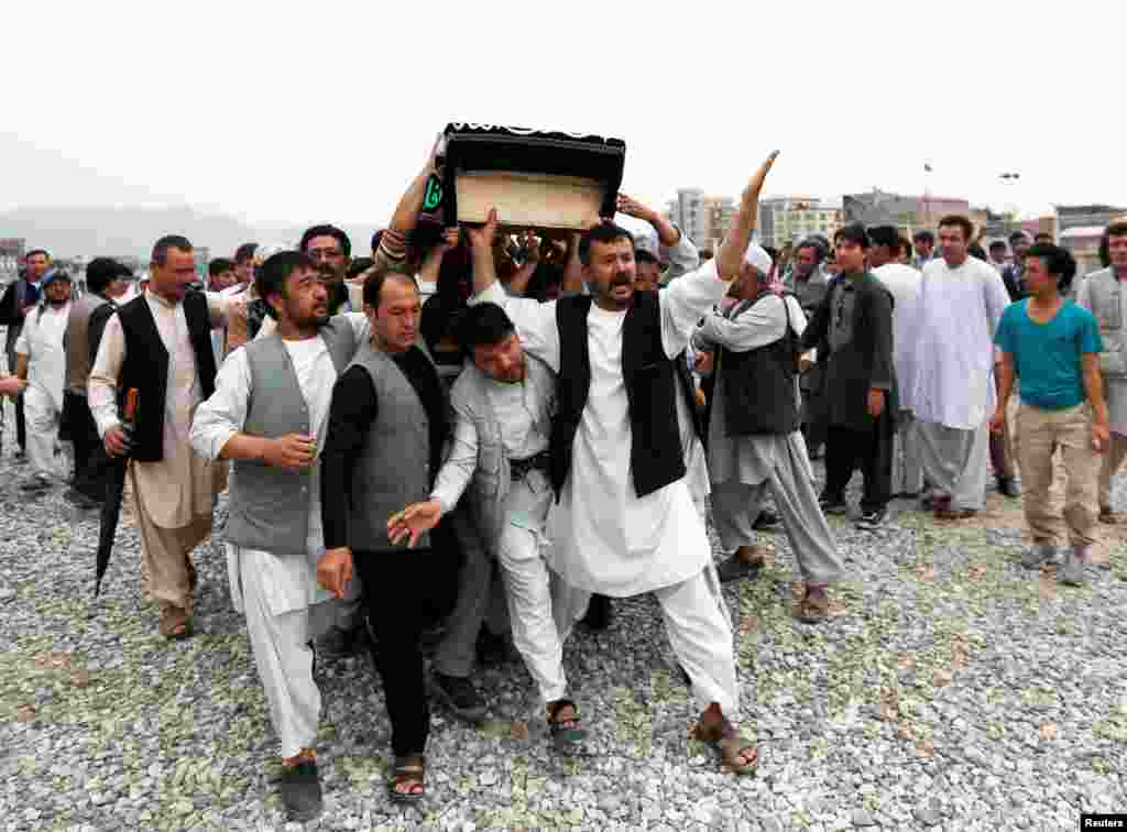 Men carry the coffin of one of the victims of a suicide attack in Kabul, Afghanistan, which killed more than 80 people on July 23. (Reuters/Mohammad Ismail)