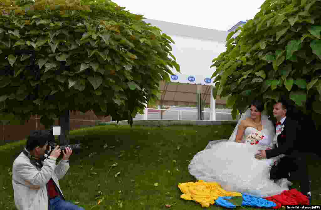 A photographer takes pictures of newlyweds in the city of Drochia, north of Chisinau.