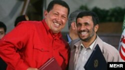 Chavez and Ahmadinejad share a laugh in 2007