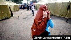Москвадагы мигранттар лагериндеги аял. 2013-жыл.