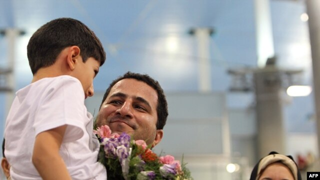Iranian nuclear scientist Shahram Amiri is welcomed by family members upon his arrival at Imam Khomeini Airport in Tehran on July 15.