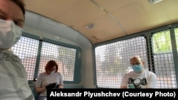 Александр Плющев, Татьяна Фельгенгауэр и Сергей Смирнов после задержания