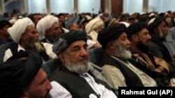 Delegates attend the fourth day of the Afghan Loya Jirga in Kabul on May 2.