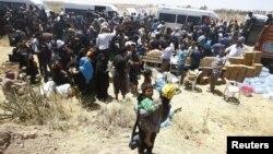 Refugjatët sirianë duke ikur në Turqi
