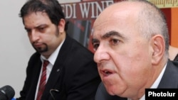 Armenia -- The head of the State Migrarion Service, Gagik Yeganian (R), at a press conference, 22Jul2010.