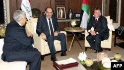 ملك الأردن عبد الله الثاني يستقبل رئيس الوزراء نوري المالكي ونظيره الأردني عبد الله النسور.