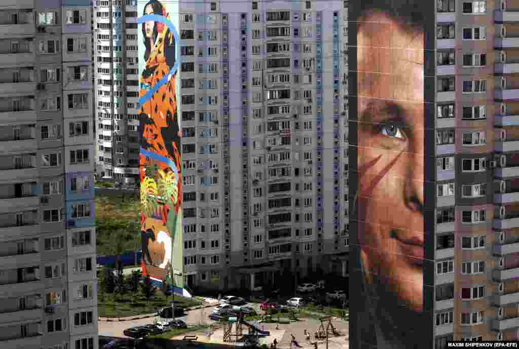 A view of a mural depicting Russia's Yuri Gagarin, the first man in space, created by Italian artist Jorit Agoch in Odintsovo, near Moscow, during a festival in which 60 artists from Russia, Spain, Germany, Japan, Australia, England, France, Brazil, Canada, Indonesia, Hungary, Bulgaria, Mexico, Thailand, Italy, Portugal, Argentina, the United States, China, and Switzerland are participating. (epa-EFE/Maksim Shipenkov)