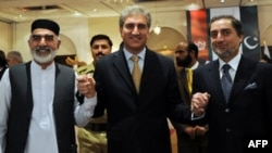 Pakistani Foreign Minister Shah Mehmood Qureshi (center), Afghan delegation head Abdullah Abdullah (right), and Northwest Frontier Province Governor Owais Ghani at the meeting in Islamabad