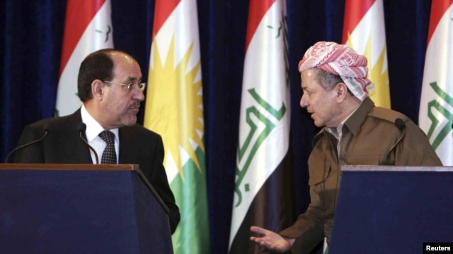 Iraqi Prime Minister Nuri al-Maliki (left) and Iraq's Kurdish regional leader Masud Barzani speak to each other during a joint news conference in Irbil in June.