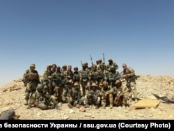 A group picture of Russian soldiers who are believed to have fought as mercenaries in Syria. (file photo)