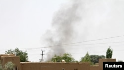 Smoke rises from a residential as the Taliban battled the Afghan security forces in Ghazni on August 10.