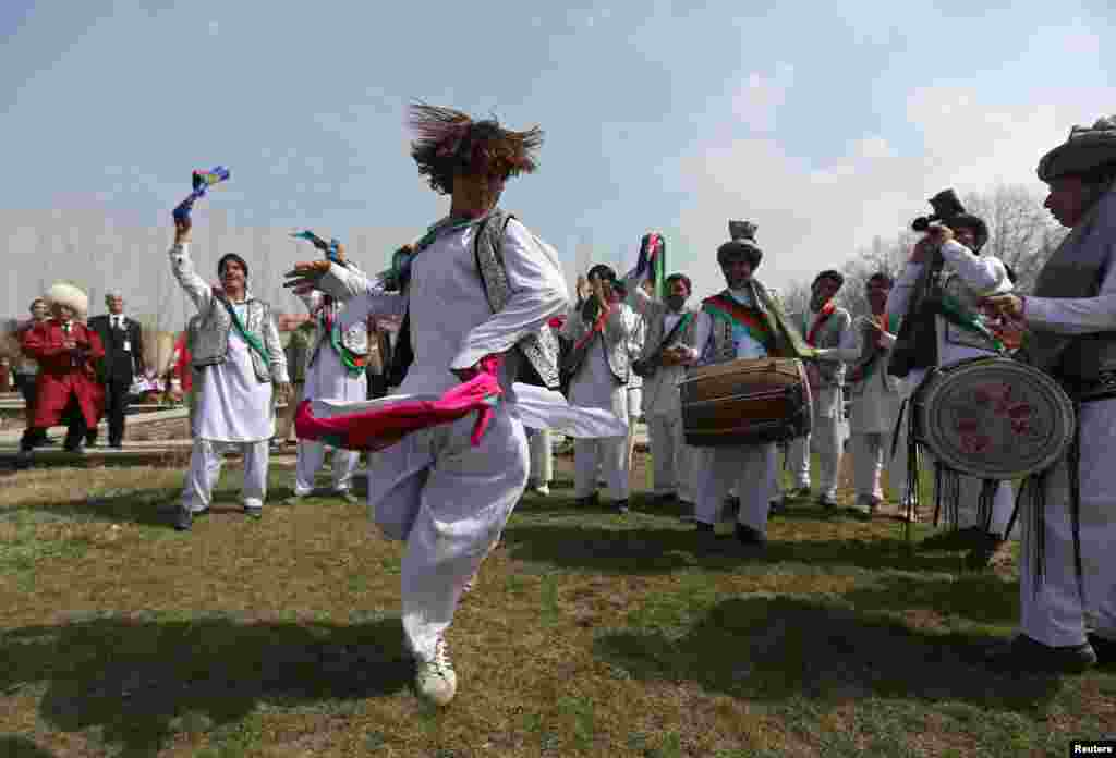 "Afghan artists perform the traditional ""attan"" dance during international Norouz celebrations in Kabul on March 27. (Reuters/Omar Sobhani)"