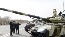 Azerbaijan - President Ilham Aliyev inspects T-90 tanks and other weapons purchased from Russia at a military base in Nakhichevan, 7Apr2014.