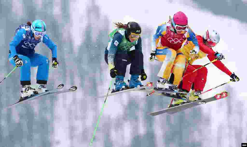 Women skiers compete in the small final of the women's freestyle ski-cross event. (epa/Daniel Karmann)