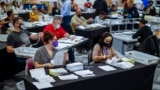 U.S. -- Absentee ballots are processed and verified by the Fulton County Registration and Elections Department in a large room at State Farm Arena in Atlanta, Georgia, USA, 04 November 2020.