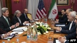 U.S. Secretary of State John Kerry (left) holds a meeting with Iran's Foreign Minister Javad Zarif (right) over Iran's nuclear program in Lausanne, Switzerland, on March 17.