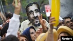 A mask depicting Iranian president Mahmud Ahmadinejad is seen during a protest against his presence at the UN General Assembly in New York on September 26.