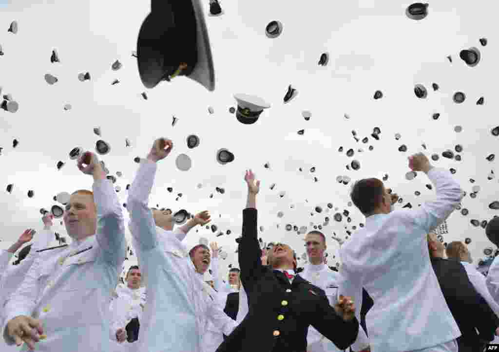 Graduates of the U.S. Naval Academy celebrate during a graduation ceremony at the Navy-Marine Corps Memorial Stadium in Maryland on May 24. (AFP/Mandel Ngan)