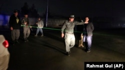 Security forces block roads at the site of the attack in Kabul on November 28.