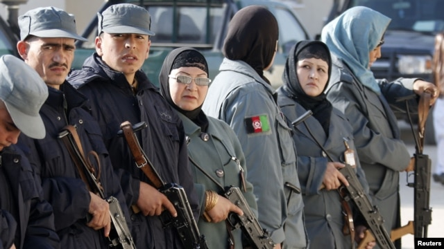 Male and female Afghan National Police officers line up before a drill at a training center in Mazar-e Sharif. Less than 1 percent of police officers are women.