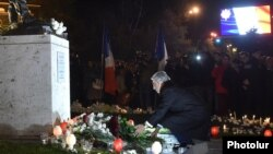 Armenia - President Serzh Sarkisian lays flowers in Yerevan's France Square during a candlelight vigil for victims of terrorist attacks in Paris, 14Nov2015.