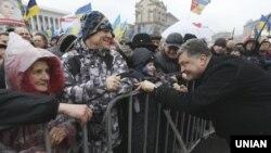 Украина үкіметіне қарсы шерулердің бірі. Киев, 12 қаңтар 2014 жыл.