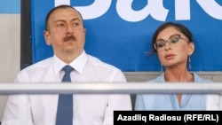 Ilham Aliyev (left) and Mehriban Aliyeva attend a sports conference in Baku last year.